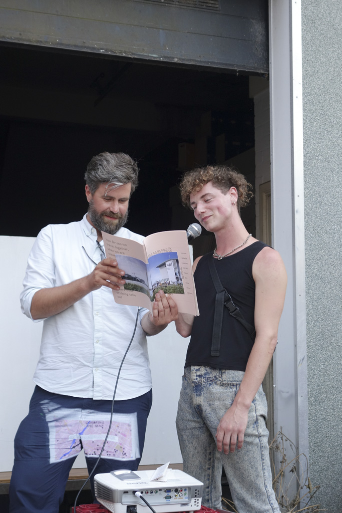 Jaroslav and Lucas reading from the book *Cruising the Map* that came out of the workshop